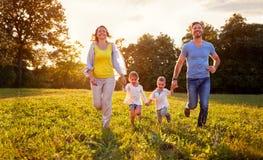 Cheerful family enjoying in nature Royalty Free Stock Photos