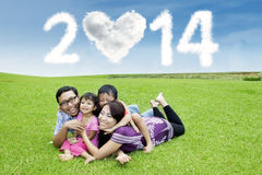 Cheerful family enjoying new year holiday Stock Photos