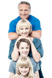 Cheerful family of four standing in a row Royalty Free Stock Image