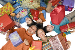 Cheerful family with gifts Royalty Free Stock Photos