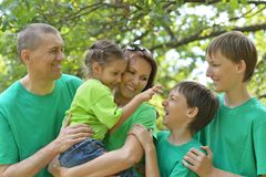 Cheerful family in green shirts Royalty Free Stock Photo