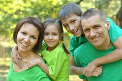 Cheerful family in green shirts Royalty Free Stock Photography