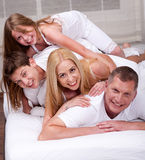 Cheerful family having fun together lying on a bed Royalty Free Stock Photography