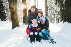 Cheerful family having fun in the winter forest Royalty Free Stock Photo