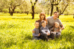 Cheerful family having a picnic. Riendly, cheerful family having a picnic Royalty Free Stock Images