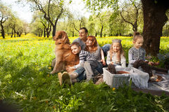 Cheerful family having a picnic. Stock Image