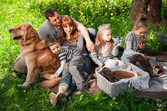 Cheerful family having a picnic. Royalty Free Stock Images