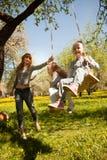 Cheerful family having a picnic. Riendly, cheerful family having a picnic Stock Photo