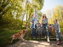 Cheerful family having a picnic. Riendly, cheerful family having a picnic Stock Image