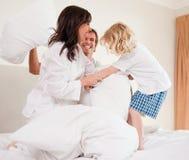 Cheerful family having pillow fight Royalty Free Stock Photos