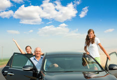 Cheerful Family In The Black Car Royalty Free Stock Image