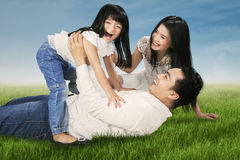 Cheerful family joking together at field Stock Image