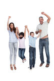 Cheerful family jumping Stock Images