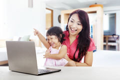 Cheerful family with laptop computer Stock Photo