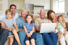 Cheerful family with laptop in living room Royalty Free Stock Photography