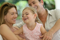 Cheerful family laughing and having fun Stock Photos