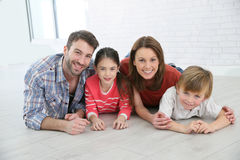 Cheerful family lying on the floor Royalty Free Stock Images