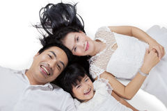Cheerful family lying in studio Royalty Free Stock Photo