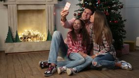 Cheerful family making christmas selfie at home stock footage