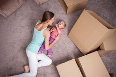 Cheerful family is making fu in process of packing Stock Images