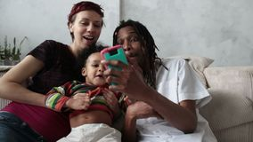 Cheerful family making selfie with smart phone stock video