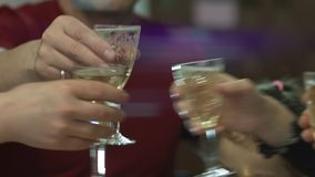 Cheerful family members clinking glasses above dinner table. Little girl eating tasty food. Alcohol and toasting, party. And celebration theme. Congratulations stock video footage