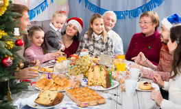Cheerful family members making conversation. During Christmas dinner Stock Images