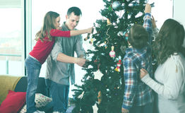 Cheerful family members preparing for Christmas. Together at home Stock Images