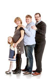 Cheerful family mom dad brother and a little Stock Images
