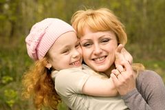 Cheerful family on the nature stock photography