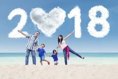 Cheerful family with numbers 2018 at shore Royalty Free Stock Image