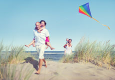 Cheerful Family Playing by the Beach royalty free stock photos