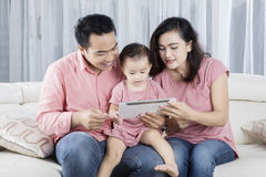 Cheerful family playing digital tablet at home Royalty Free Stock Image