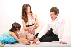 Cheerful family playing mikado Royalty Free Stock Photo
