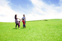 Cheerful family playing outdoor Stock Images
