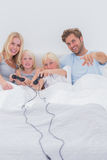 Cheerful family playing video games Stock Images