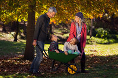Cheerful family playing with the wheelbarrow Stock Photo