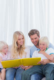 Cheerful family reading a story together Stock Photo