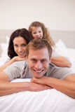 Cheerful family relaxing on the bed together Royalty Free Stock Image