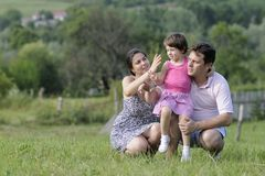 Cheerful family relaxing in nature Royalty Free Stock Photos