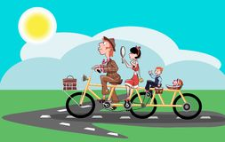 Cheerful family rides on the road on a bicycle Royalty Free Stock Photography