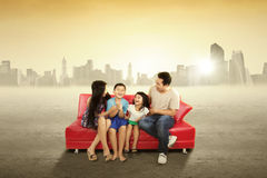 Cheerful family sitting on the couch outdoors Stock Photography