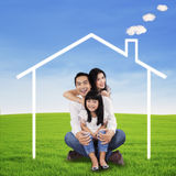 Cheerful family sitting at field Stock Images