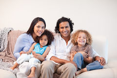 Cheerful family sitting on the sofa together Royalty Free Stock Image