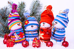 Cheerful family of snowmen Royalty Free Stock Image