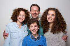 Cheerful family with son and daughter smiling together. Portrait of a cheerful family with son and daughter smiling together royalty free stock photos