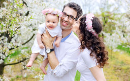 Cheerful family in the spring orchard Royalty Free Stock Photo