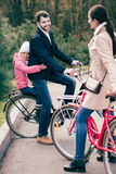 Cheerful family standing with bicycles Stock Photography
