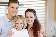 Cheerful family standing in the kitchen Royalty Free Stock Photos