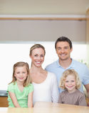Cheerful family standing in the kitchen together Royalty Free Stock Photography